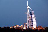 The illuminated Burj al Arab hotel in the evening, Dubai, United Arab Emirates, Middle East, Asia