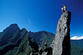 Two climbers standing on the top of a mountain peak, Trois Salazie, Gros Morne, Ille de la Réunion, Indian Ocean
