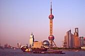 Oriental Pearl Tower at Huangpu river at dusk, Shanghai, China, Asia