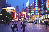 People and houses with neon signs in the evening, Nanjing Road, Shanghai, China, Asia