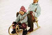 Mother and daughter sledding, Kuhtai, Tyrol, Austria