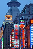 Buildings with neon signs in the evening, Shanghai, China, Asia