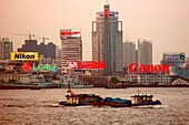 High rise buildings at Huangpu river at dusk, Shanghai, China, Asia