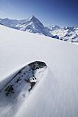 Snowboarder skiing down slope, Kuehtai, Tyrol, Austria