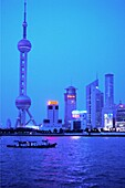 View over the river at Oriental pearl tower in the evening, Pudong, Shanghai, China, Asia