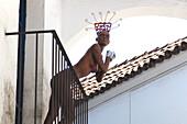 Naked mannequin on a balcony, Poble Espanyol, Barcelona, Spain, Europe