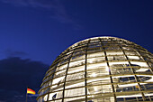 Reichstag dome and German flag at night, Berlin, Germany