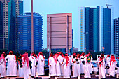 Group of arab men in front of high rise buildings, Sheik Zayed Road, Dubai, UAE, United Arab Emirates, Middle East, Asia