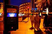 Arabs crossing at street at night, Dubai, UAE, United Arab Emirates, Middle East, Asia