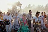 Walking Pilgrims in the sanddust, Simpecado, ox carriage with symbol of the Virgin Mary, Romería al Rocío, El Rocío, pilgrimage, Andalusia, Spain