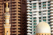 Minaret of a mosque in front of high rise buildings, Dubai, UAE, United Arab Emirates, Middle East, Asia