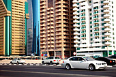 Cars on a street in front of high rise buildings, Dubai, UAE, United Arab Emirates, Middle East, Asia