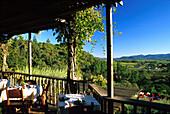 Tables at veranda of Auberge du Soleil hotel and restaurant, Napa Valley, California, USA, America