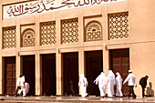 Arabs in front of the entrance of a mosque, Dubai, UAE, United Arab Emirates, Middle East, Asia
