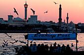 People on an Abra ferry on Dubai Creek in the evening, Dubai, UAE, United Arab Emirates, Middle East, Asia