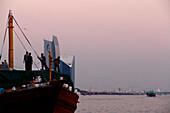 People and boats at Dubai Creek in the evening light, Dubai, UAE, United Arab Emirates, Middle East, Asia
