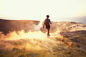 Person walking through sulphur vapour, Caldera, Gran Cratere, Vulcano, Aeolian Islands, Italy