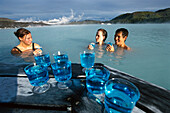 Visitors drinking cocktails, Blue Lagoon, geothermal spa with water from the power plant, Grindavik, Island