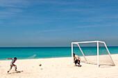 Father and son playing football, Jumeira Beach Sport, Dubai, United Arab Emirates, UAE