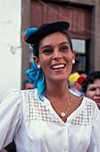 Young woman at pilgrimage to Maria Virgen del Pino, Teror, Gran Canaria, Canary Islands, Spain