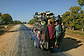 overloaded mini bus, country road, Burma, Myanmar