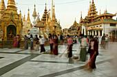 women sweeping to gain merit for the next life, Shwedagon Pagoda, Yangon, Myanmar