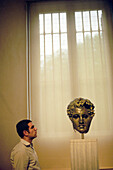 A man looking at a sculpture at the Prado, Madrid, Spain, Europe