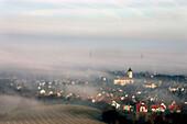 Village in early morning fog, Merdingen, Baden-Wuerttemberg, Germany