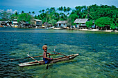 Child in an Outrigger boat, Papua New Guinea, New Ireland, Kavieng