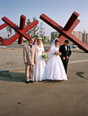 Newlyweds posing in front of the war memorial, Khimki, Moscow, Russia