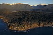 Aerial, West Coast, forest, alps, Luftaufnahme Abendlicht, Westkueste, Suedinsel, NZ, Natural, dense coastal forest, the wild west coast, background Southern Alps