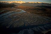 Aerial, Cook rivermouth, West Coast, Luftaufnahme Abendlicht, Westkueste, Suedinsel, NZ, Natural, dense coastal forest, the wild west coast, background Southern Alps