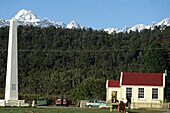 View of smallest Youth Hostel in front of forest and alps, Okarito, West Coast, New Zealand, Oceania