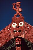 Carved Tekoteko figure in the sunlight, Rotorua, North Island, New Zealand, Oceania