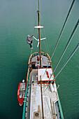 Friedensreich Hundertwasser climbs the mast of his boat Regentag, New Zealand