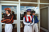 Three young female jockeys in the uniform, Auckland races, Auckland, North Island, New Zealand