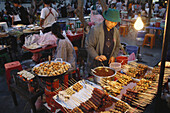 People at cookshops at Na Phra Lan old town in the evening, Bangkok, Thailand, Asia