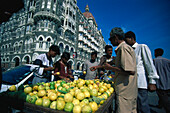 Fruit vendor in front of the Taj Mahal hotel, Bombay, India, Asia