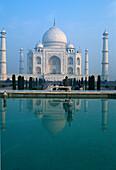 Reflection in the water basin in front of the Taj Mahal, Agra, Uttar Pradesh, India, Asia