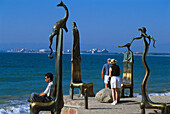 Sculptures and people on the waterfront in the sunlight, Malecon, Puerto Vallarta, Jalisco, Mexico, America