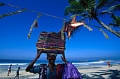 Cloth dealer and christmas decoration on the beach of Kovalam, Kerala, India, Asia
