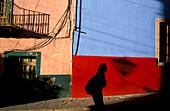 Shadow on colorful walls at Centro Historico, Guanajuato, Mexico