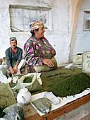 Market saleswoman selling tobacco, Market, Silk Road, Uzbekistan