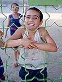 Children behind fence, Silk Road Uzbekistan