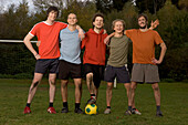 Five young male soccer players in a row
