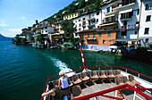 Gandria , People on excursion boat leaving Gandria, Lake of Lugano, Tessin, Switzerland
