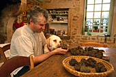 Farmer showing truffles to his dog, Domain dr Bramarel, Grignan, Tricastin, Provence, France