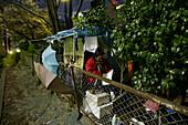 Homeless former truck driver, reading, self made shelter, Tokyo