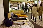 Homeless sleeping in Shinjuku underground Station, permitted only between 23:00 and 5:00, Shinjuku underground Station, Tokyo, Japan