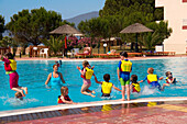 Children jumping into a swimming pool, Kid's Club, San Augustino Resort, Peloponnese, Greece
